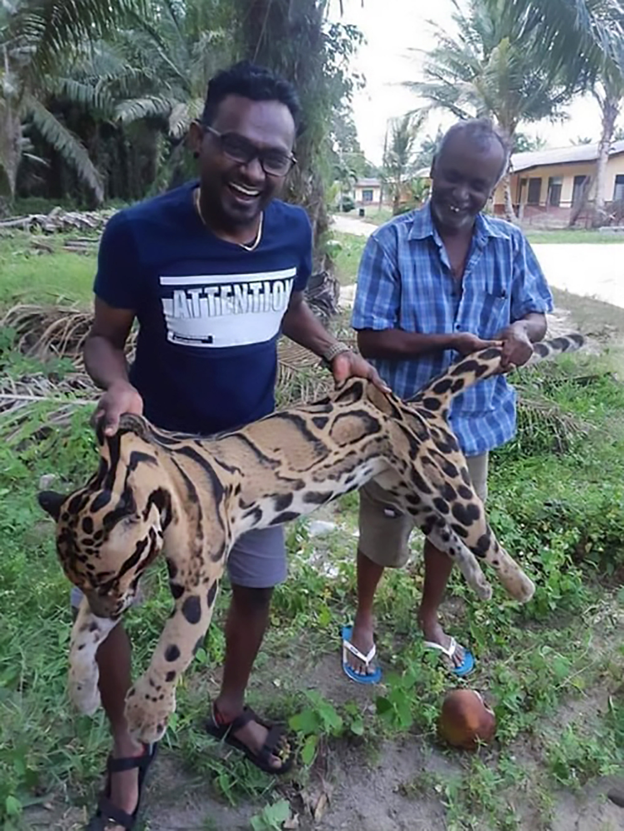 The suspected poachers with the leopard. Credit: AsiaWire