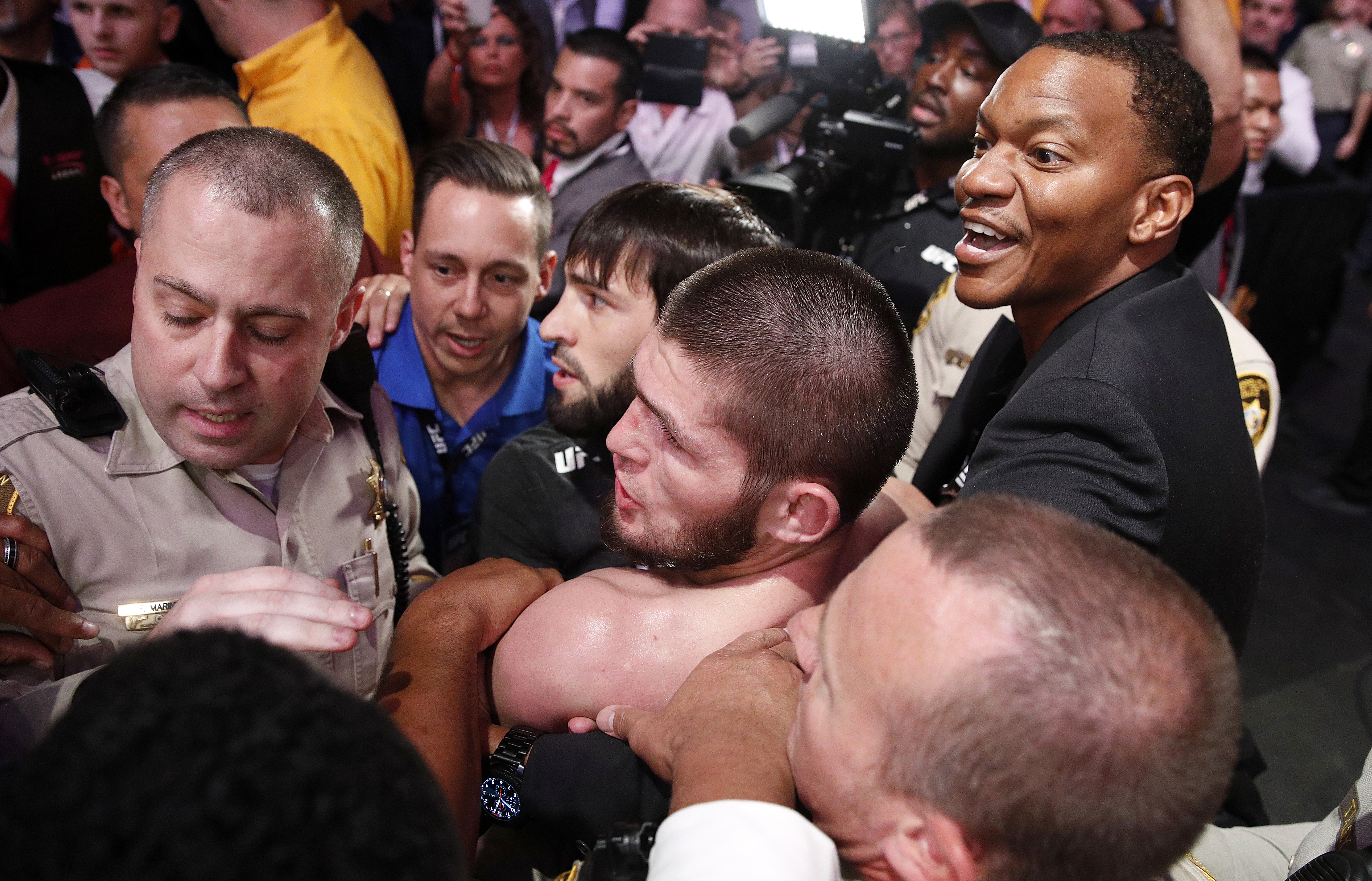 Security hold back Khabib after the incident. Image: PA Images