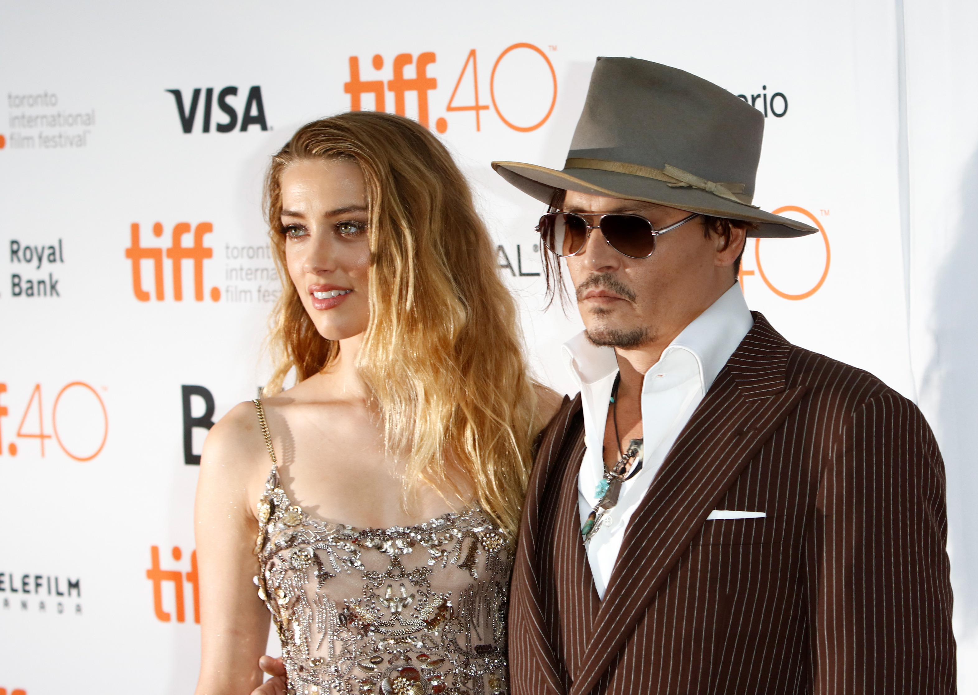 Johnny Depp accuses ex-wife of leaving poo in their bed