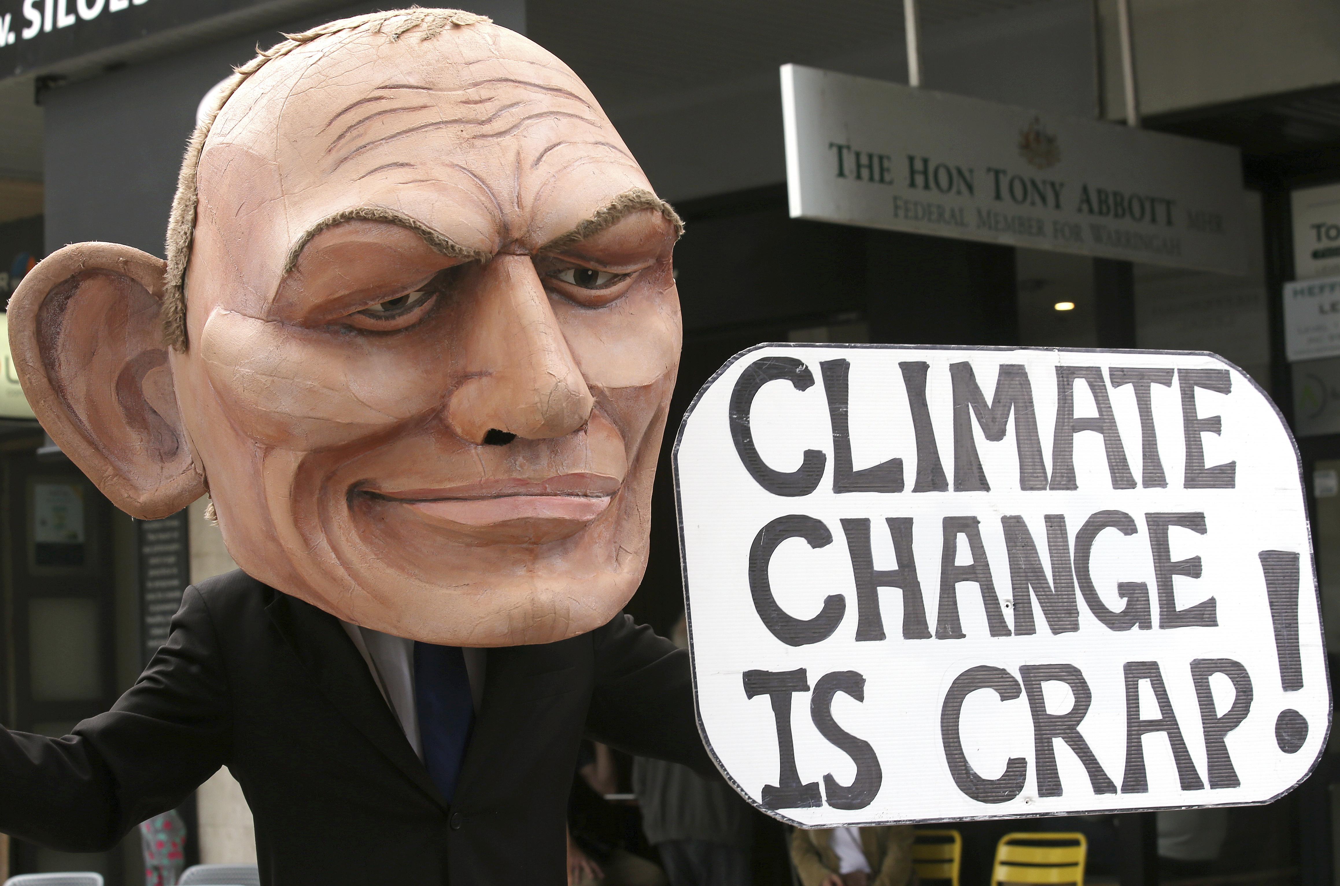 Protestor outside Mr Abbott's office. Credit: PA