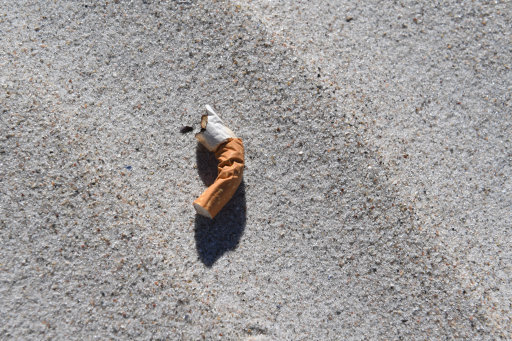 A cigarette butt lying on the beach. Credit: PA