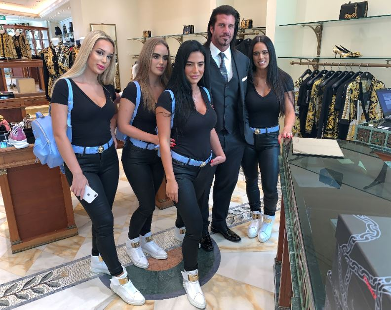 The crew enjoying a spot of shopping in Versace. Credit: Candy Shop Mansion/LADbible