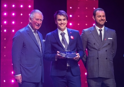 The Prince of Wales still looks amused with Danny Dyer (right) and winner of Mentor of the Year Award Rahul Mehra. Credit: PA