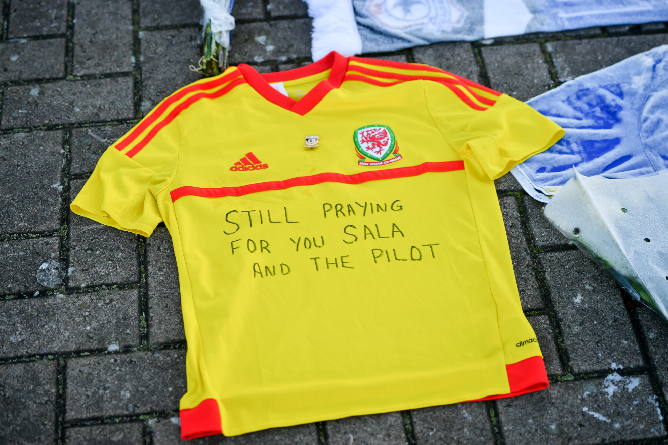 Fans have been laying tributes to the lost footballer outside the Cardiff City stadium. Credit: PA