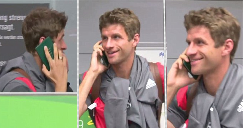 WATCH: Thomas Muller Dodges The Press By Having A Phone Call...On His Passport