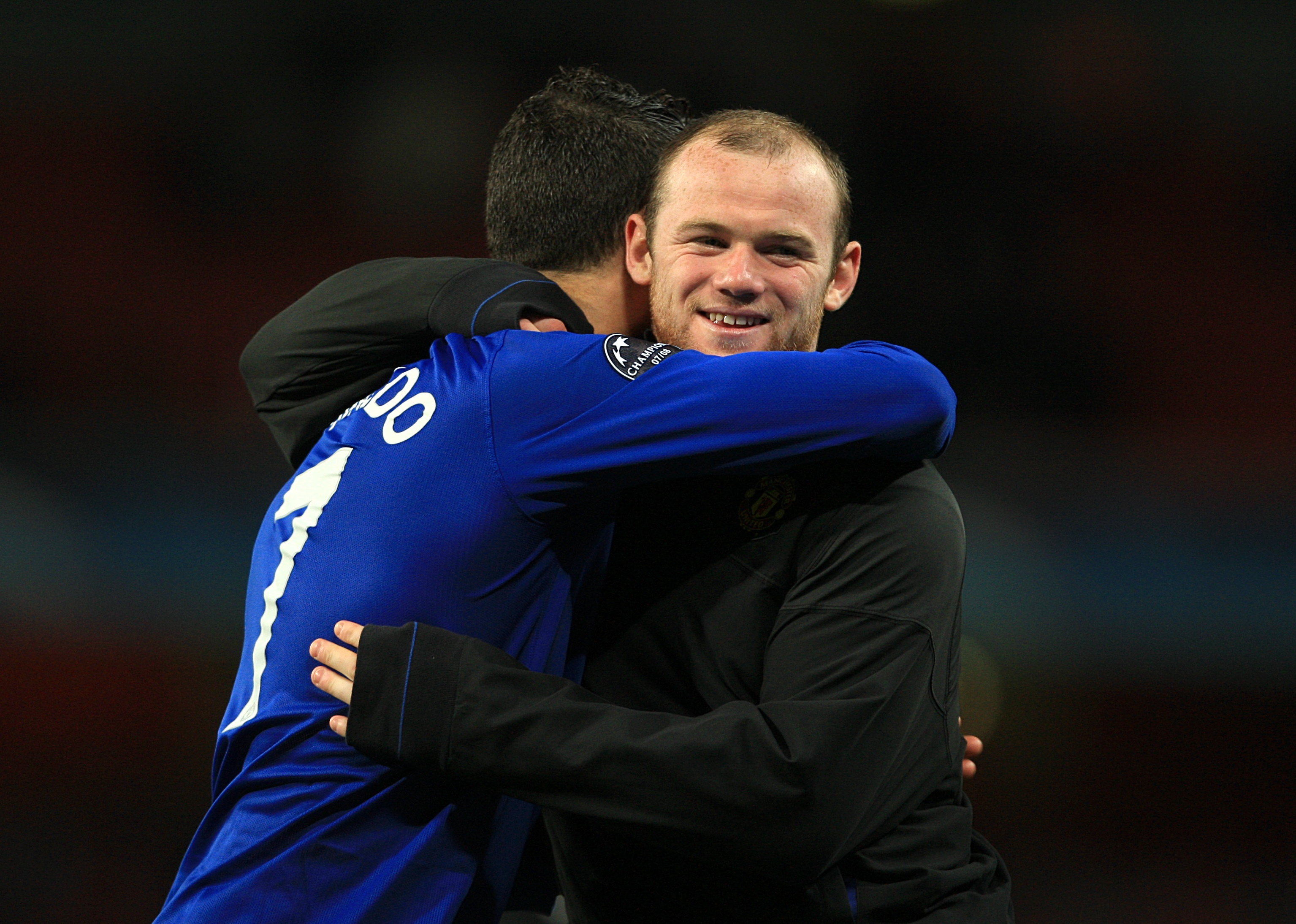 Rooney and Ronaldo embrace. Image PA Images