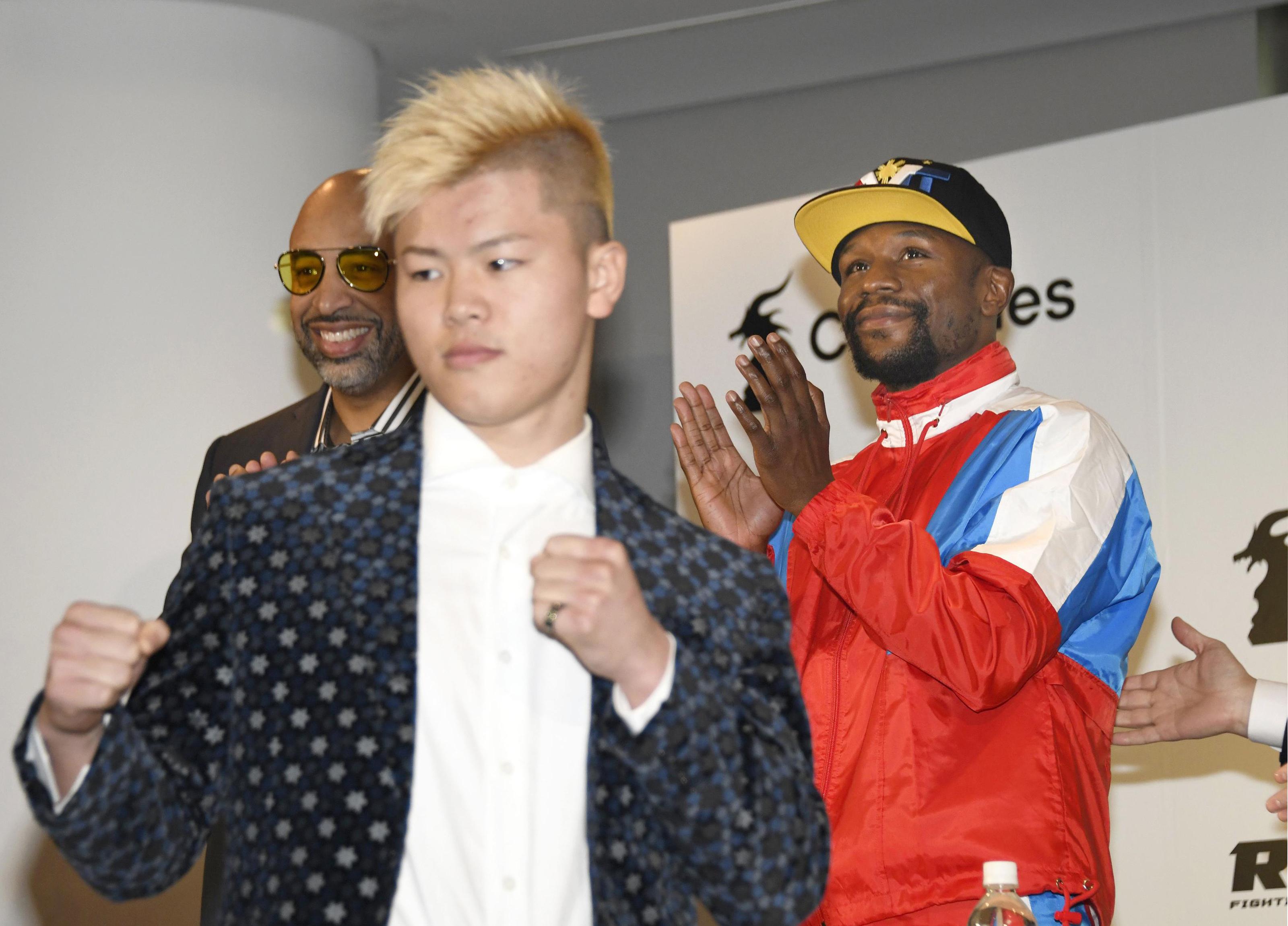 Mayweather and Nasukawa ahead of the fight. Credit: PA