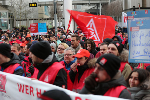 Workers striking outside the BMW factory in Munich. Credit: PA