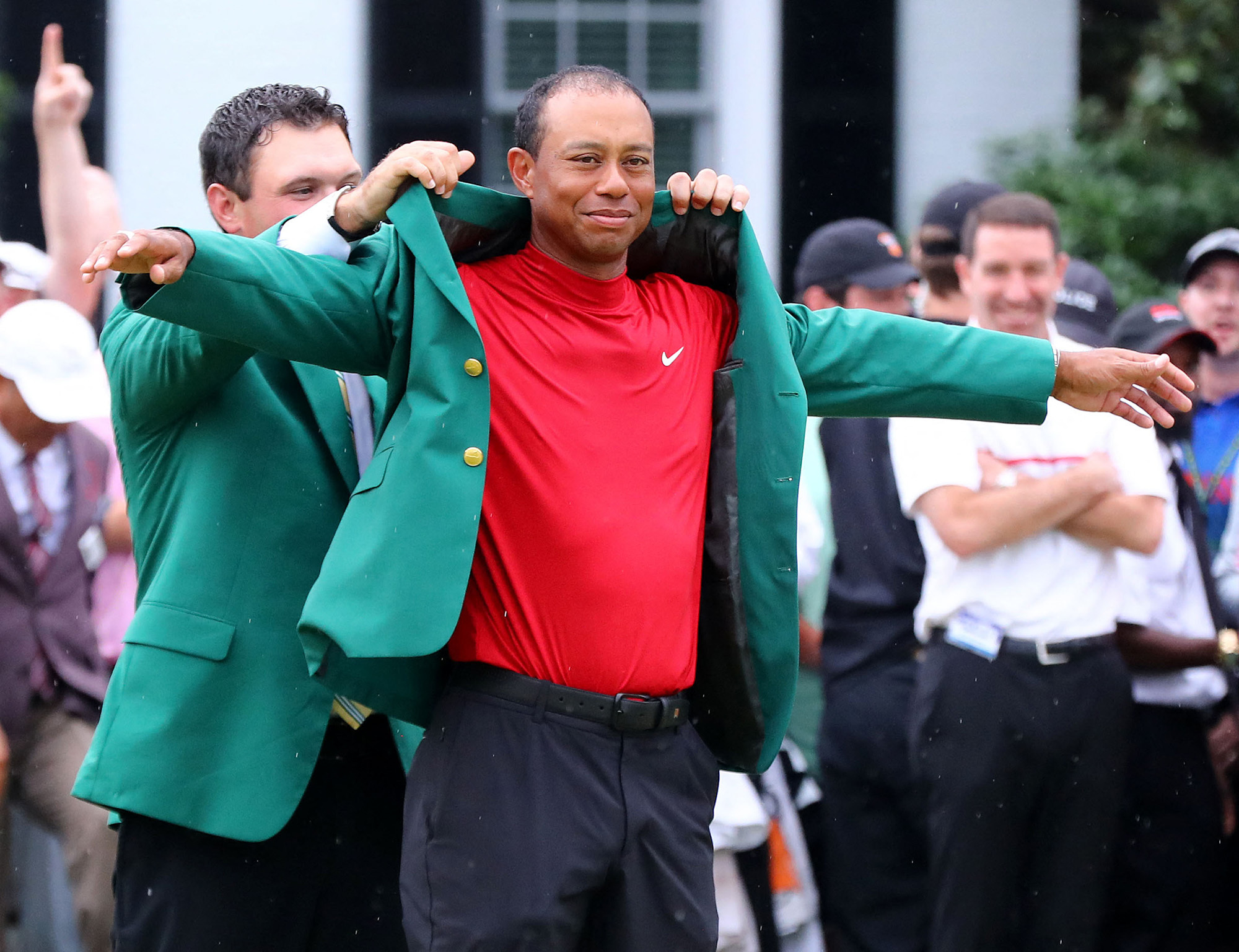 Woods collects his green jacket from Patrick Reed. Image: PA Images