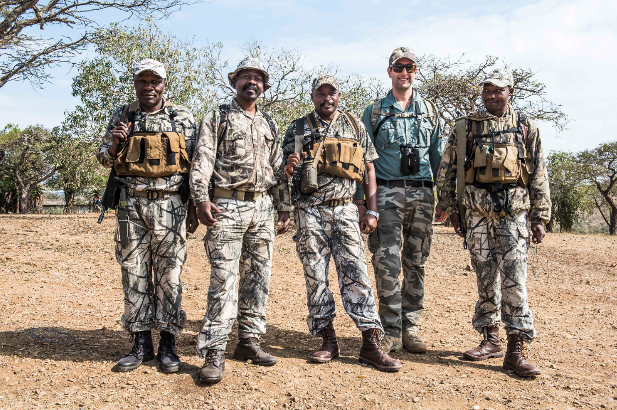 Andrew Campbell (second from right) with a group of field rangers. Credit: Peter Chadwick