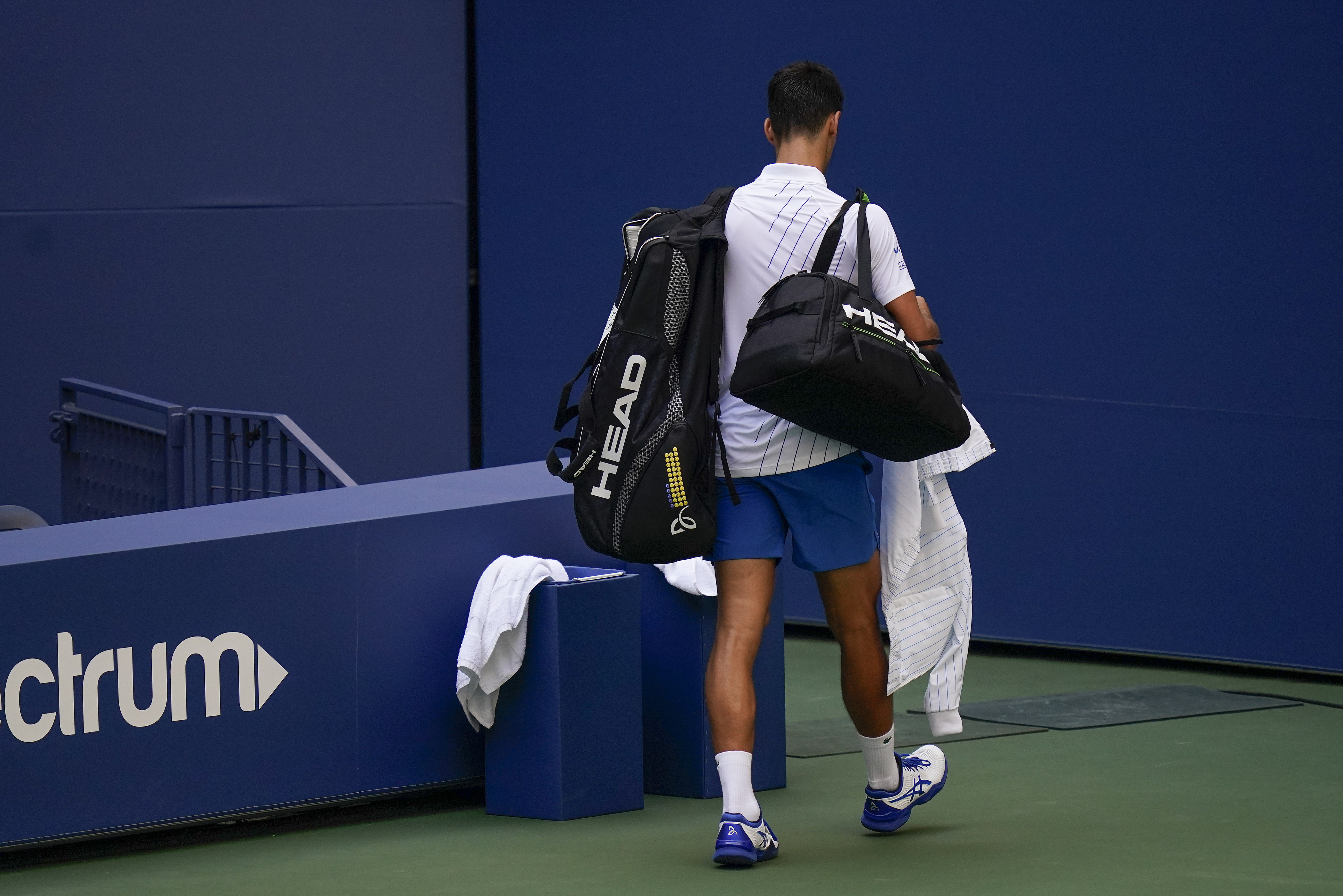 Djokovic Kicked Out Of Us Open For Hitting Ball Into Line Judge S Throat Ladbible