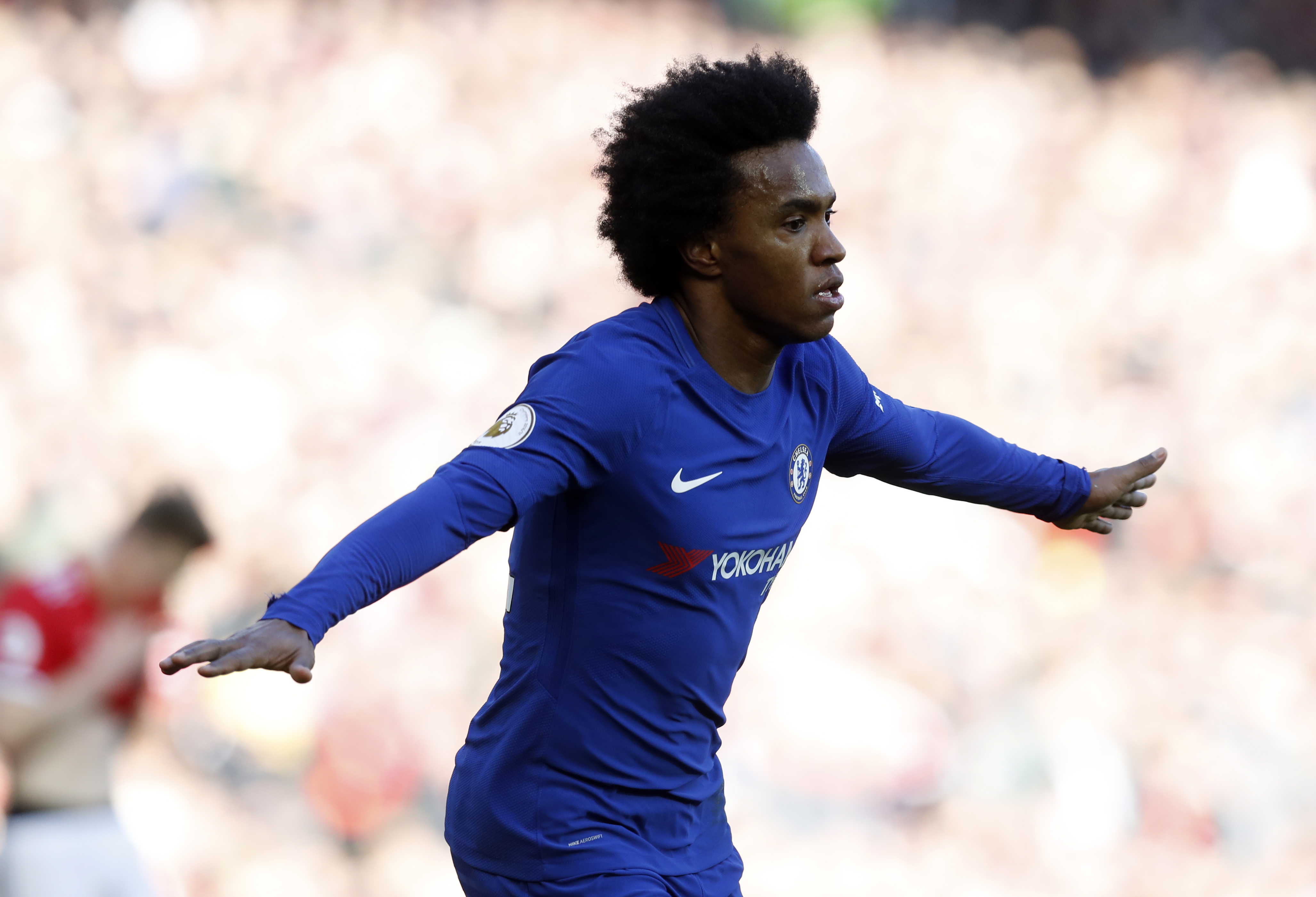 Willian wheels away in celebration. Image: PA