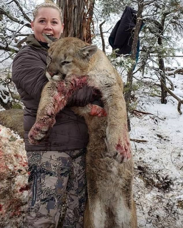 Esplin with the dead mountain lion. Credit: Facebook