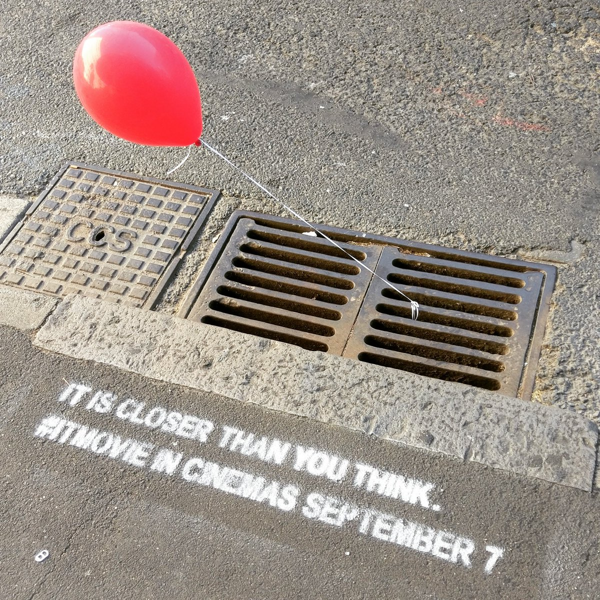 Creepy 'It' stunt sees red balloons appear in drains across Sydney