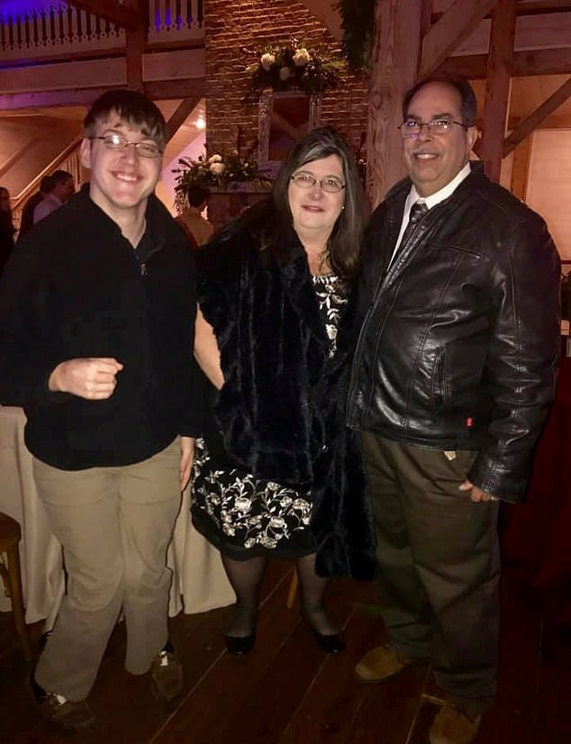 Mrs Denicola with her husband and stepson. Credit: SWNS/Kim Harris Denicola