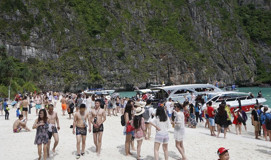 Tourists fill the beach at Maya Bay. Credit: PA