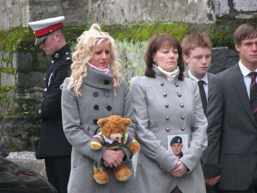 Marine Travis Mackin's family at his funeral service at St Andrew's Church, in Plymouth. Credit: PA