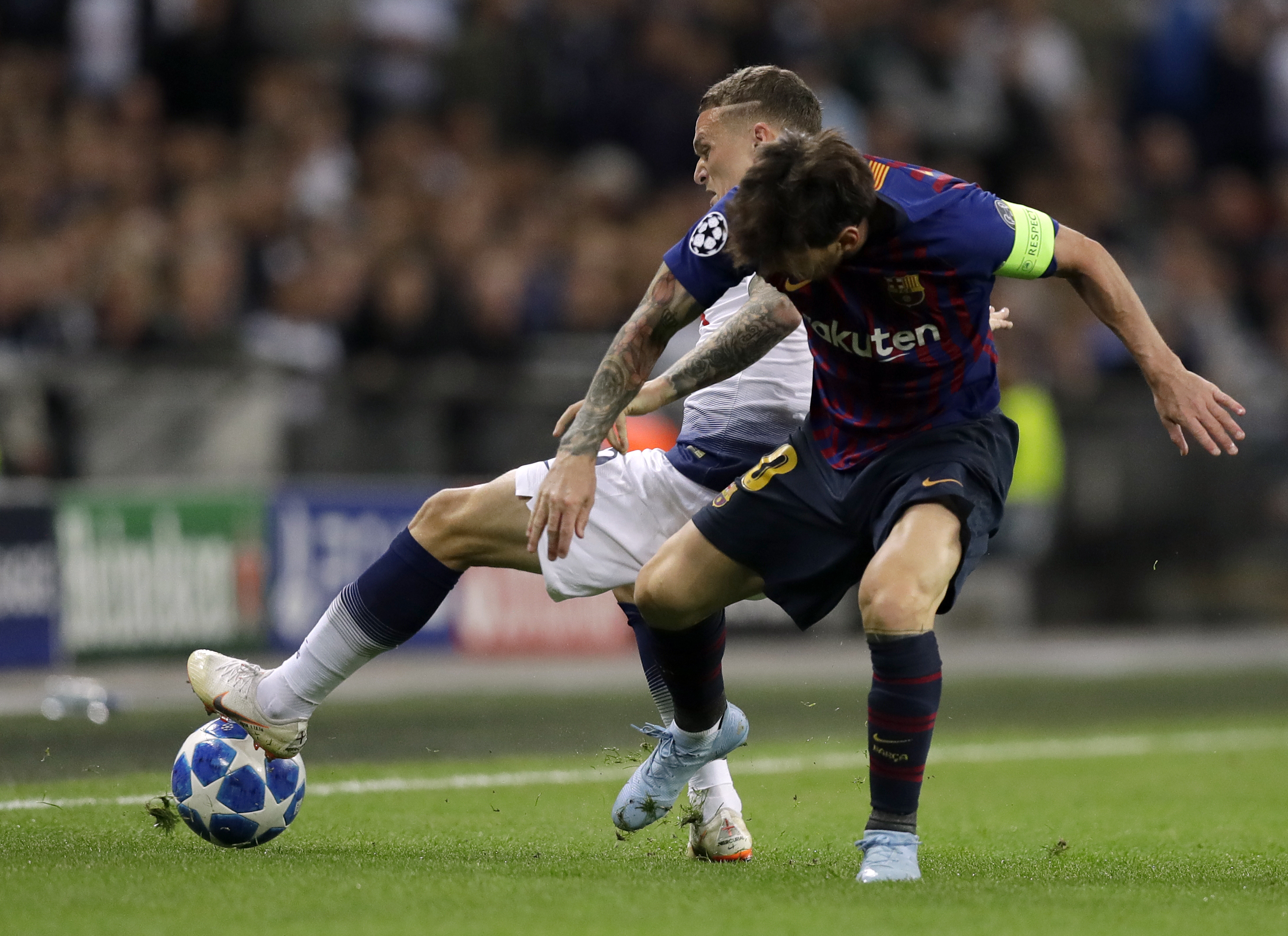 Messi and Trippier duel for the ball. Image: PA