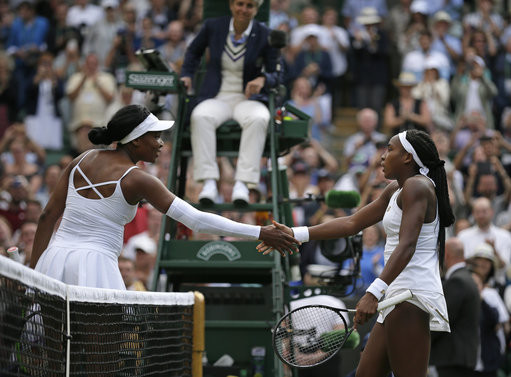 Cori 'Coco' Gauff, right, greets the United States's Venus Williams at the net after winning. Credit: PA