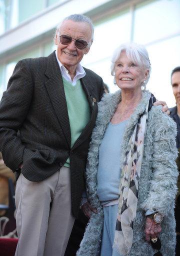 Comic book hero Stan Lee, posing with his wife Joan Lee back in 2011. Credit: PA