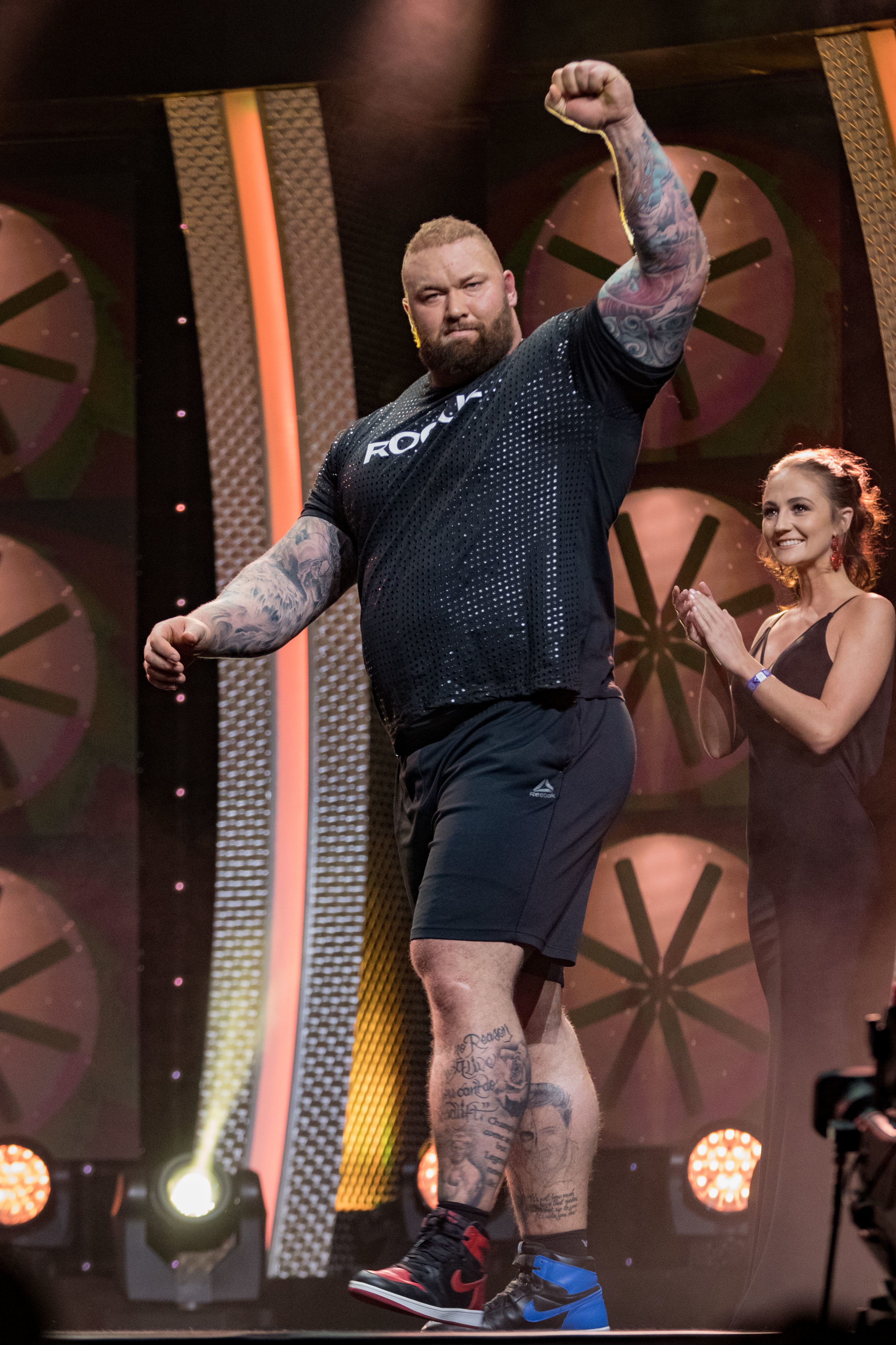 The strongman claimed the tile after dead-lifting a ton. Credit: PA
