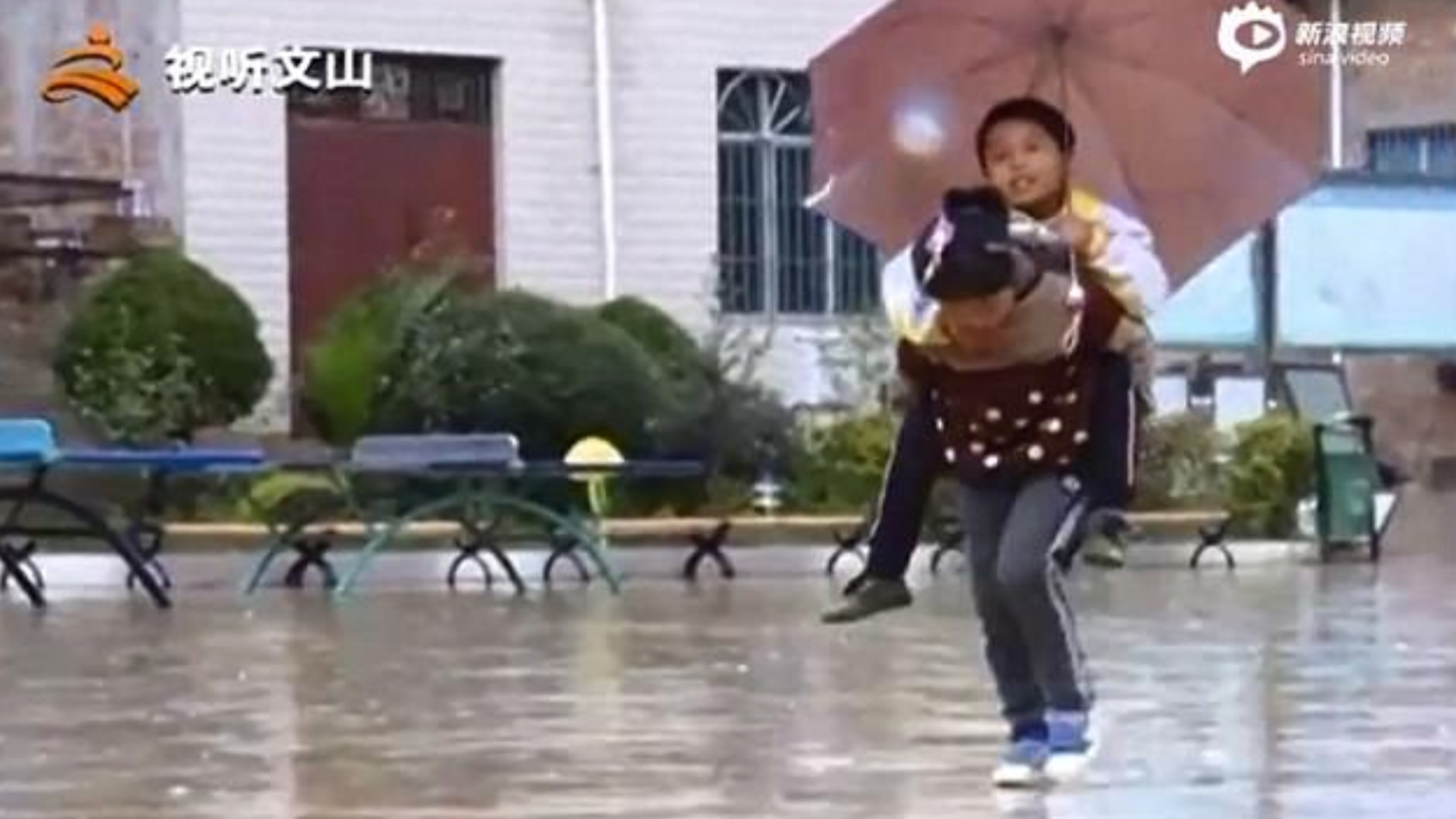 Nine-Year-Old Girl Carries Disabled Brother To School On Her Shoulders Every Day