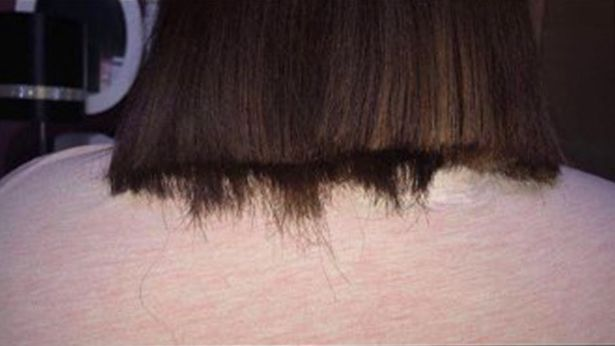 Her cut had to be salvaged by her cousin but left it much shorter than she originally wanted. Credit: Wales News Service