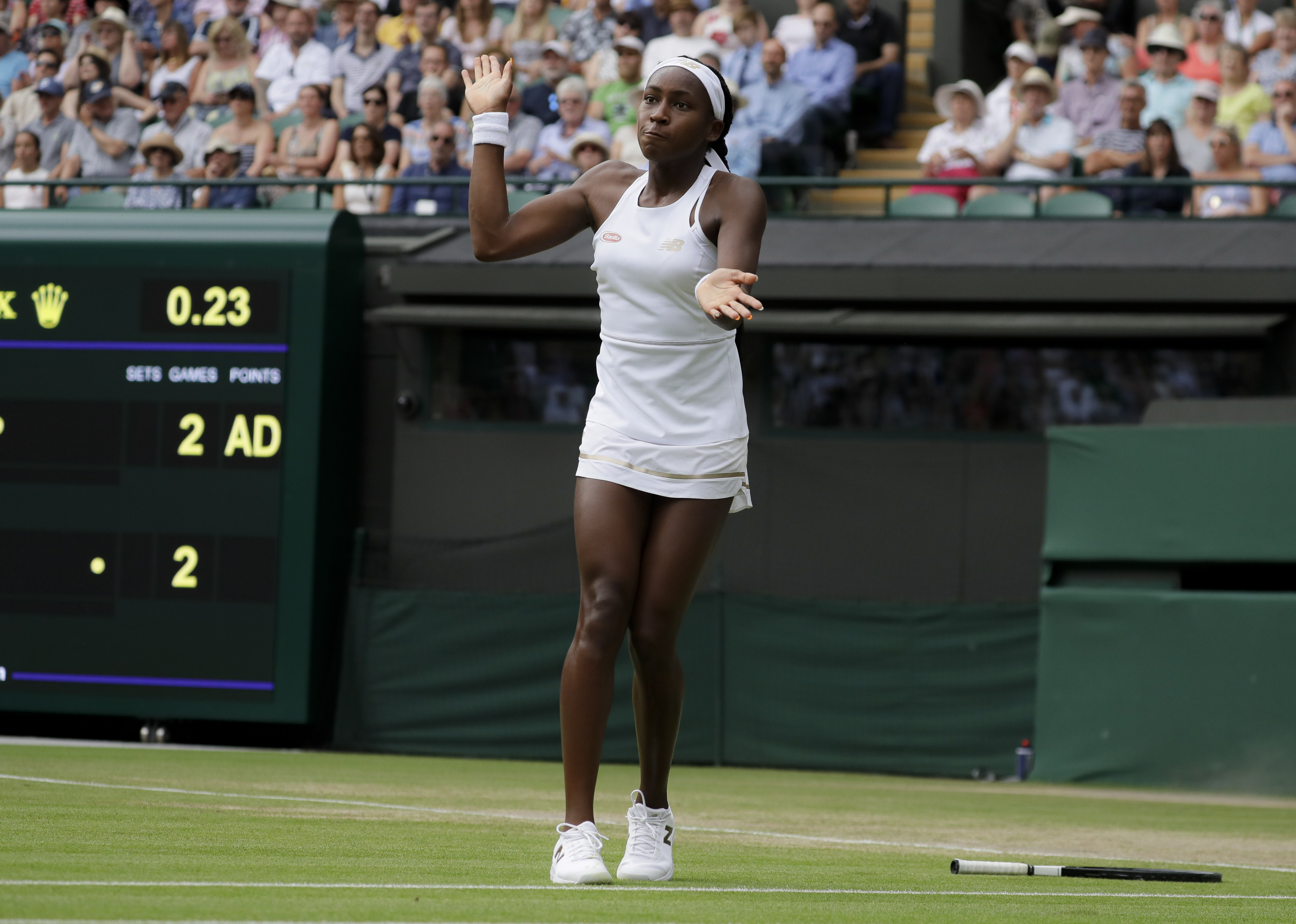 Gauff drops her racquet after missing a point against Halep. Credit: PA