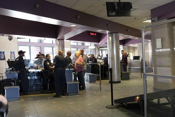 Customs officials check passports. Credit: PA