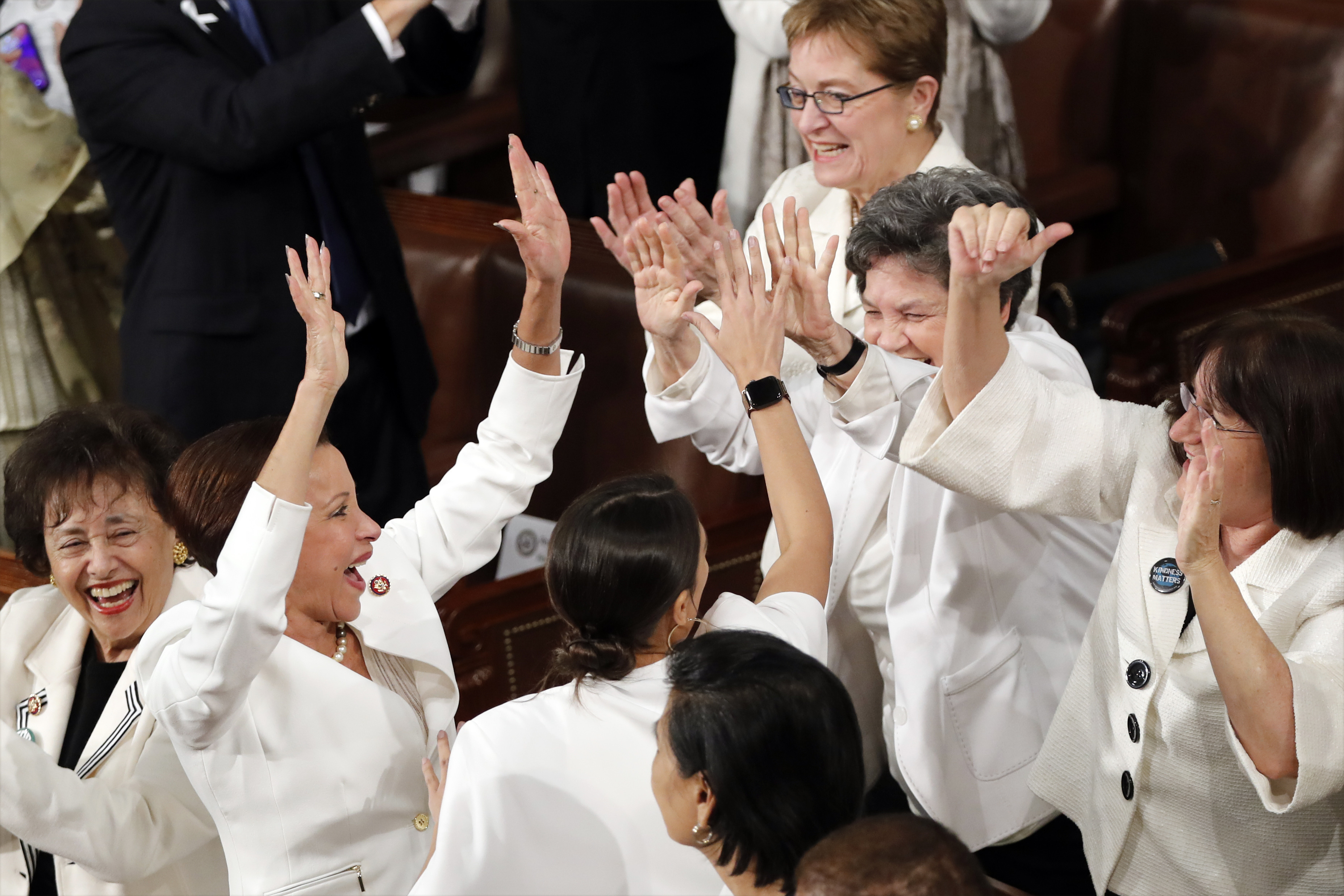 Members of Congress cheer after President Donald Trump acknowledges the record number of women in congress. Credit: PA