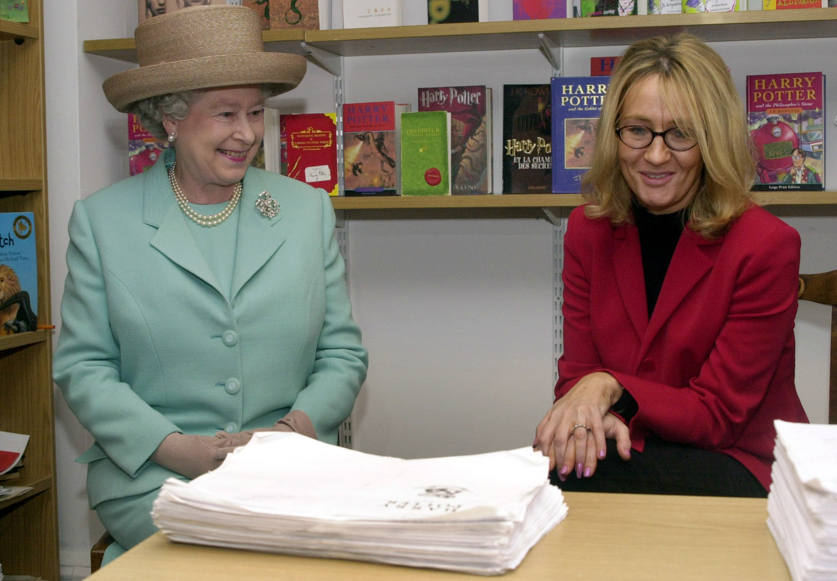 JK Rowling with the queen