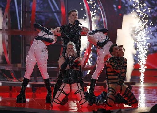 Hatari of Iceland perform the song 'Hatrio mun sigra' during the 2019 Eurovision Song Contest. Credit: PA