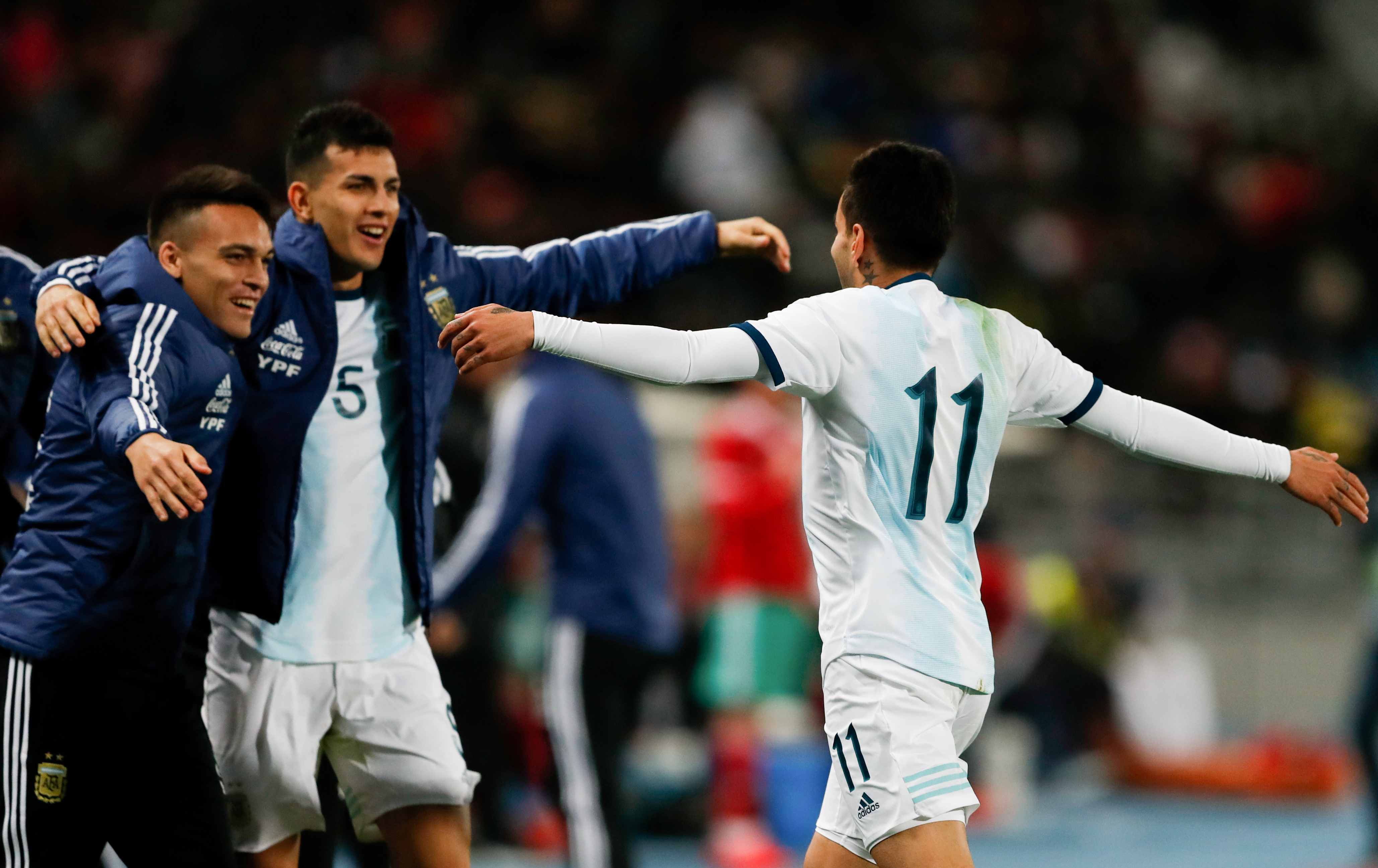 Argentina players celebrate their win. Image: PA Images