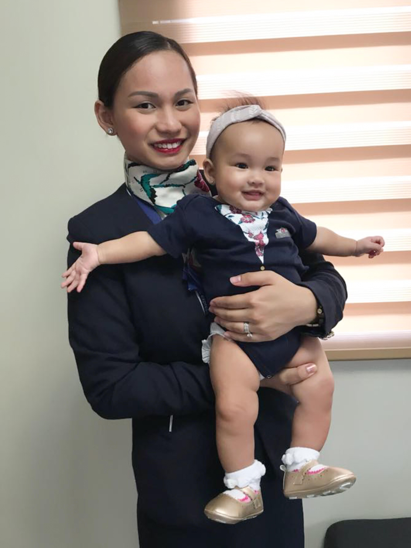 Flight attendant Patrisha Organo with her daughter Jade. Credit: Caters