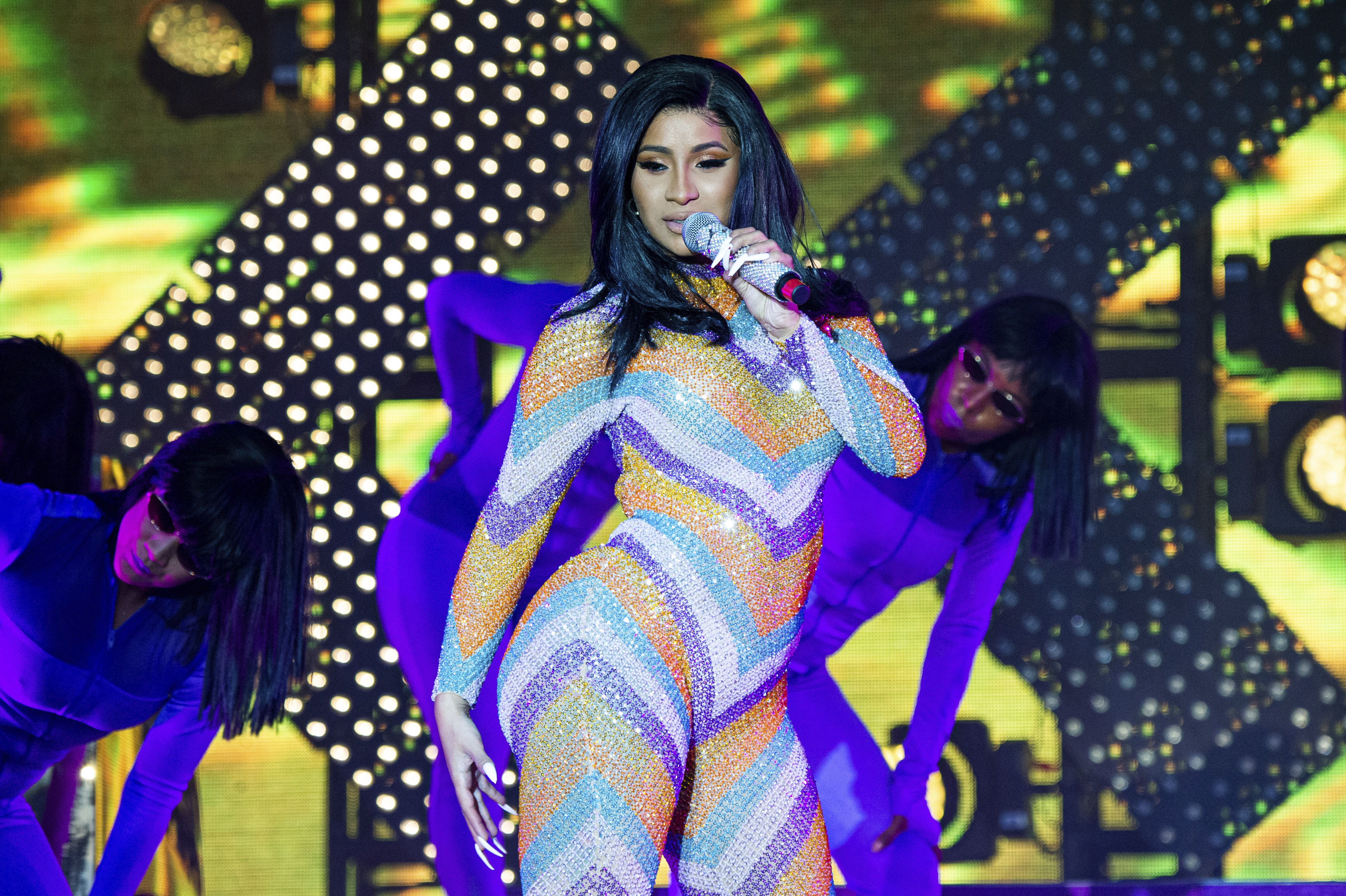 Cardi B managed to split her jumpsuit with her energetic stage antics. Credit: PA