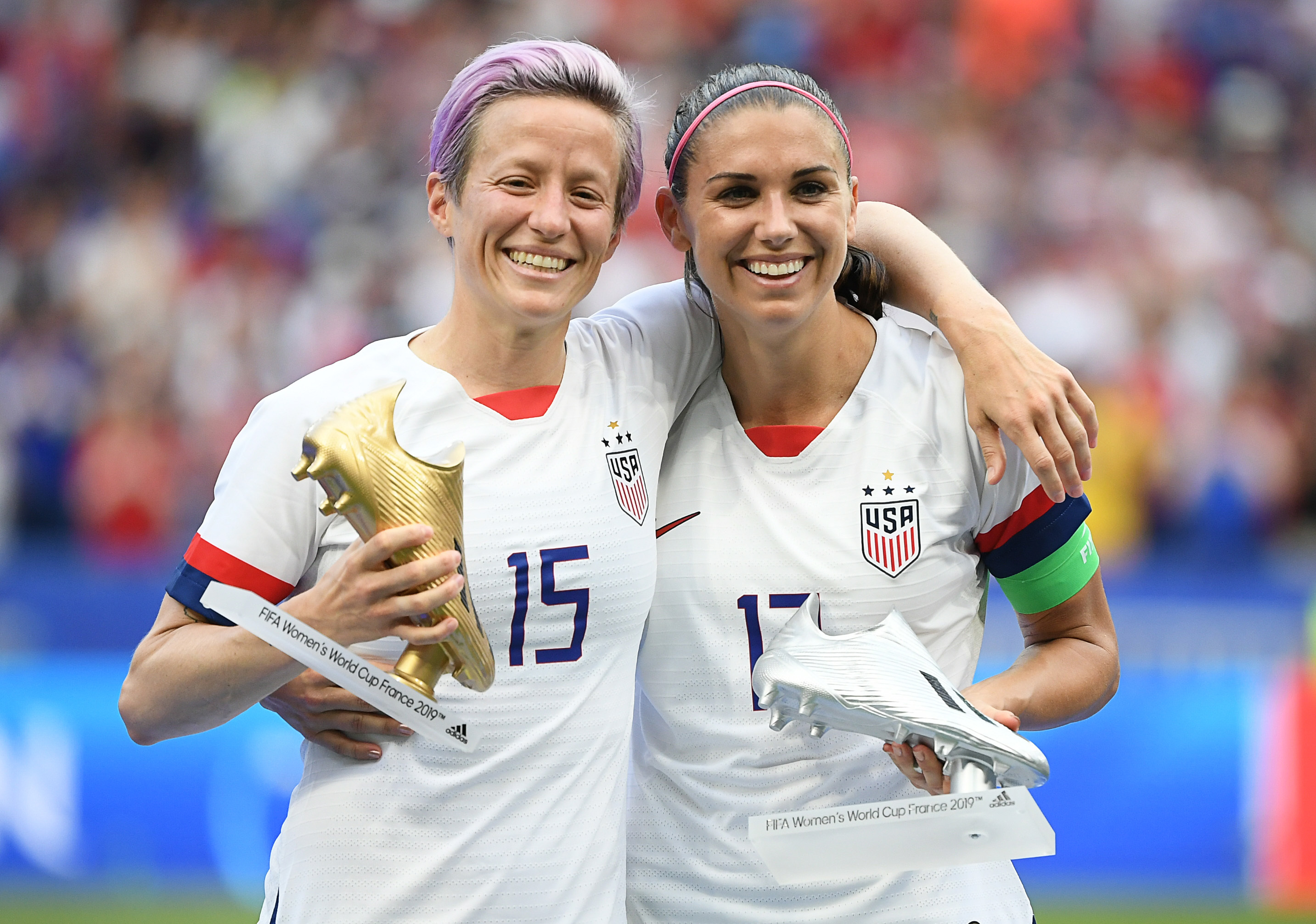 Rapinoe celebrates with her Golden Boot. Image: PA Images