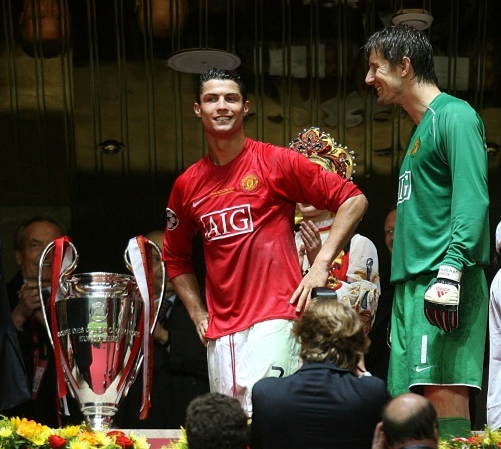 Ronaldo and van der sar next to the Champions League trophy. Image: PA