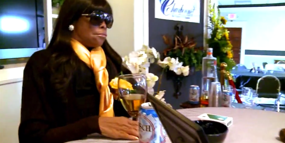 An embalmed body, posed next to a can of beer at her funeral. Credit: Channel 5
