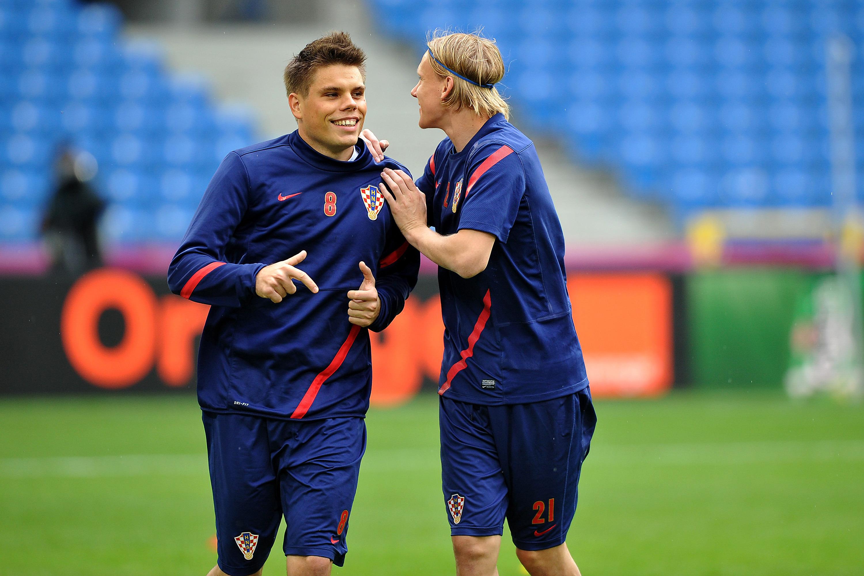 Ognjen Vukojevic and Domagoj Vida. Credit: PA