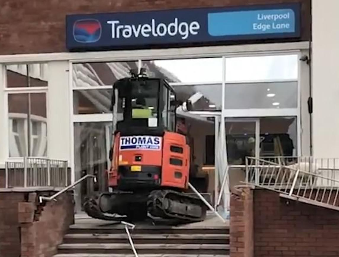 Builder uses digger to smash up new hotel lobby