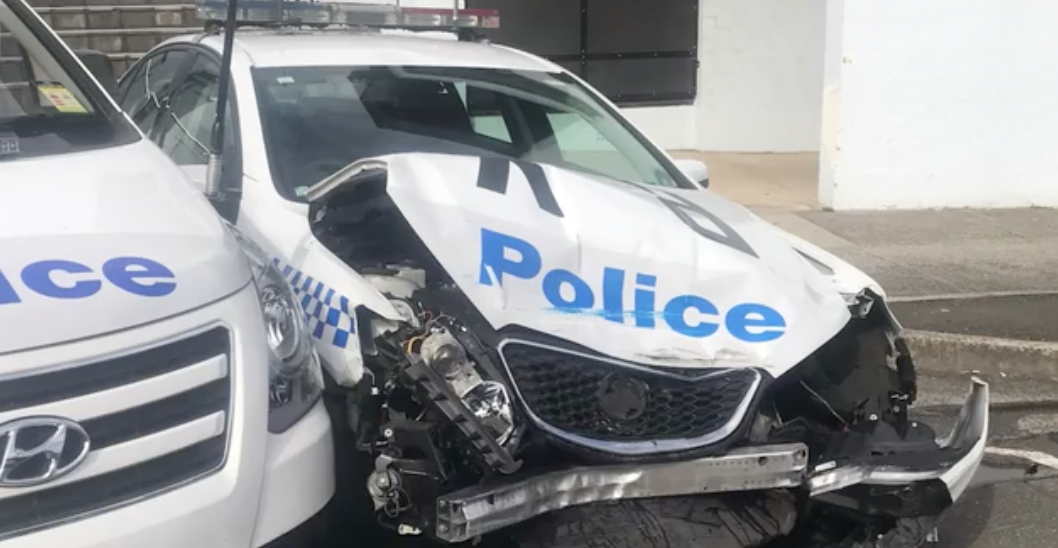 Van vehiclerying $200m worth of ice crashes into parked police auto