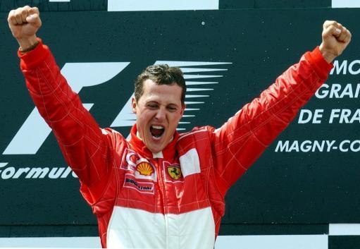 Michael Schumacher celebrates after winning the French Formula One Grand Prix on the Magny-Cours racetrack in France, 21 July 2002. Credit: PA