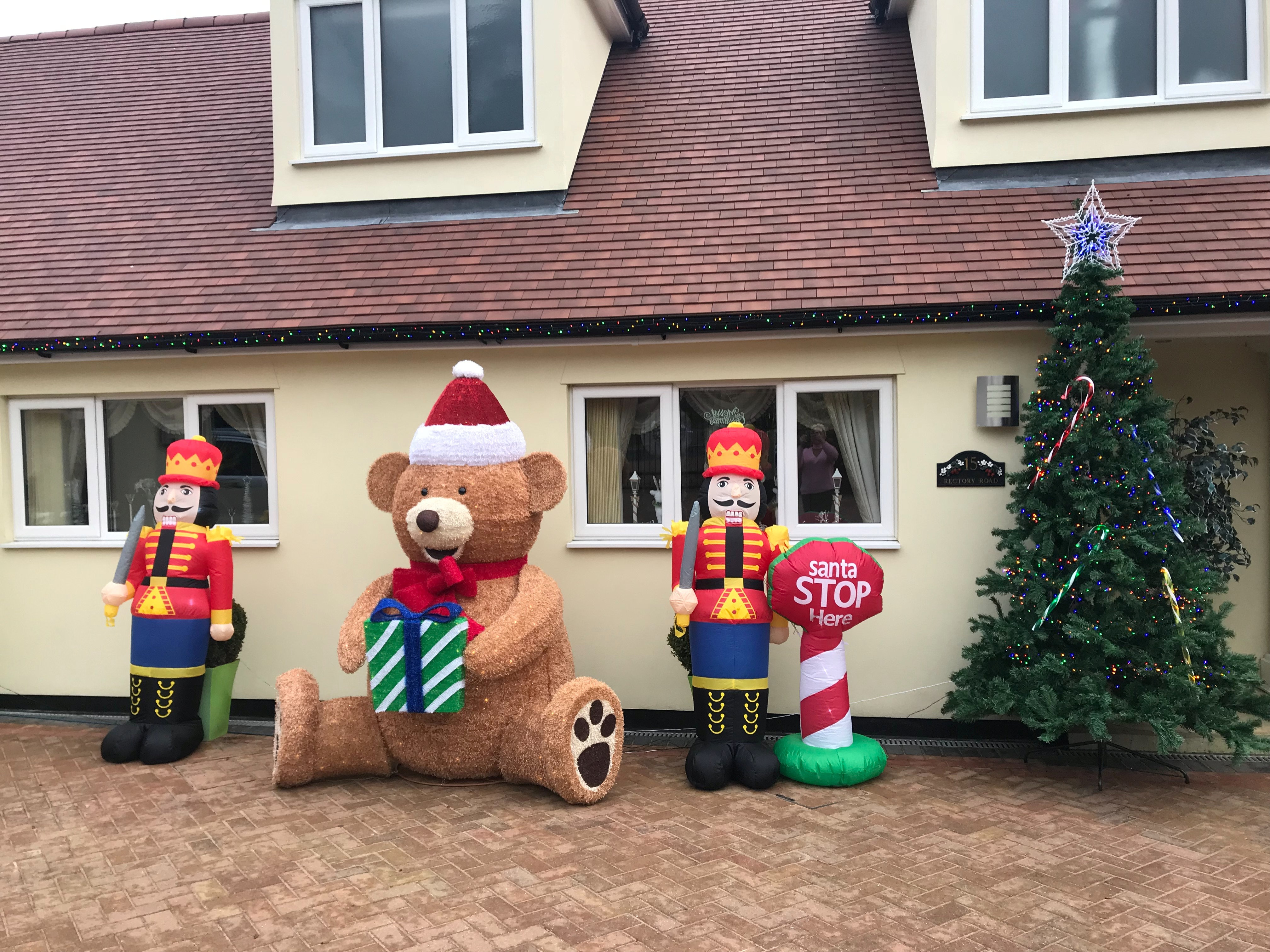 The outside of her home is as festive as the inside. Credit: SWNS