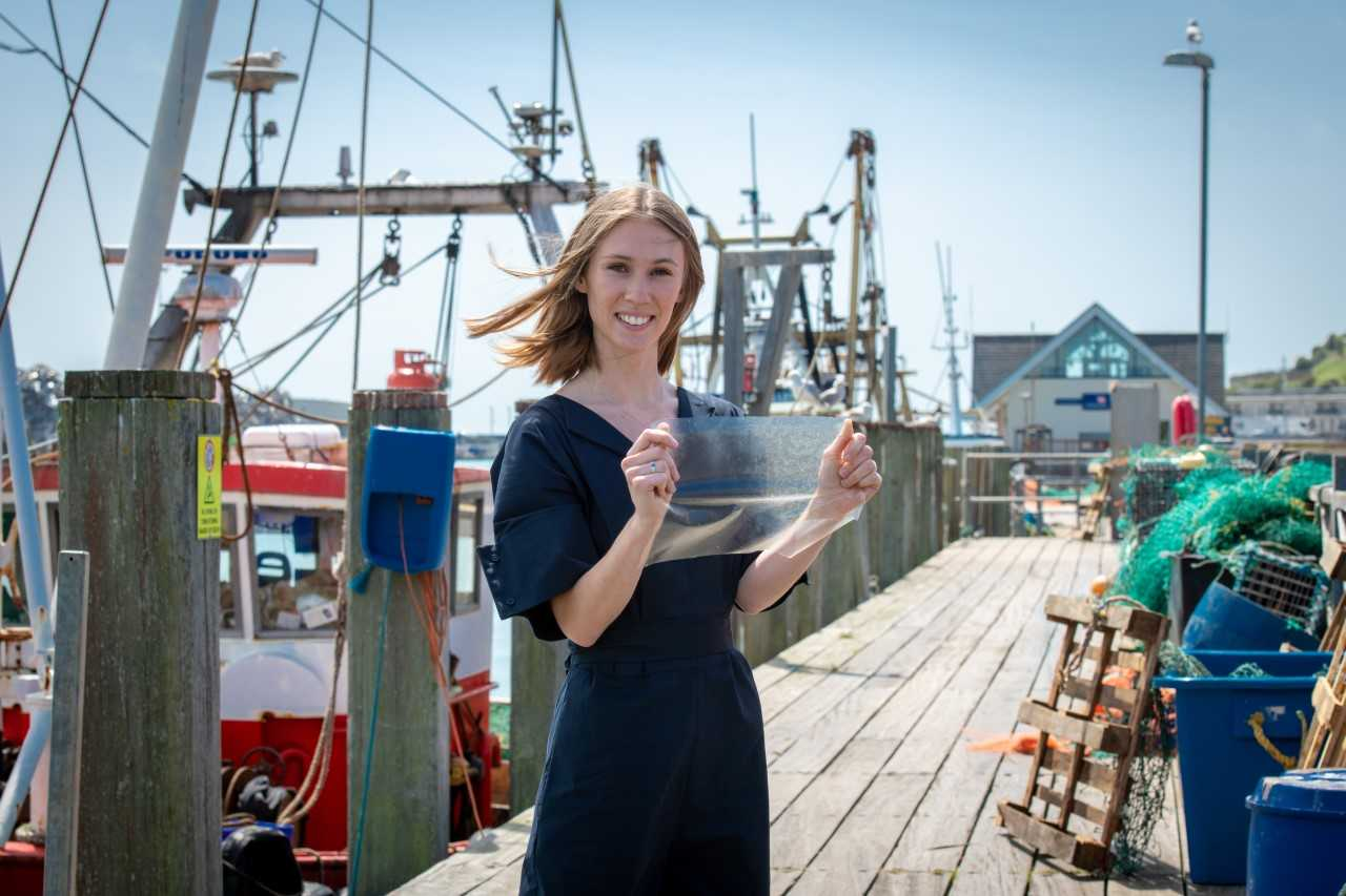 Lucy Hughes has invented a new bioplastic called Marinatex, made using fish skin and red algae. Credit: University of Sussex