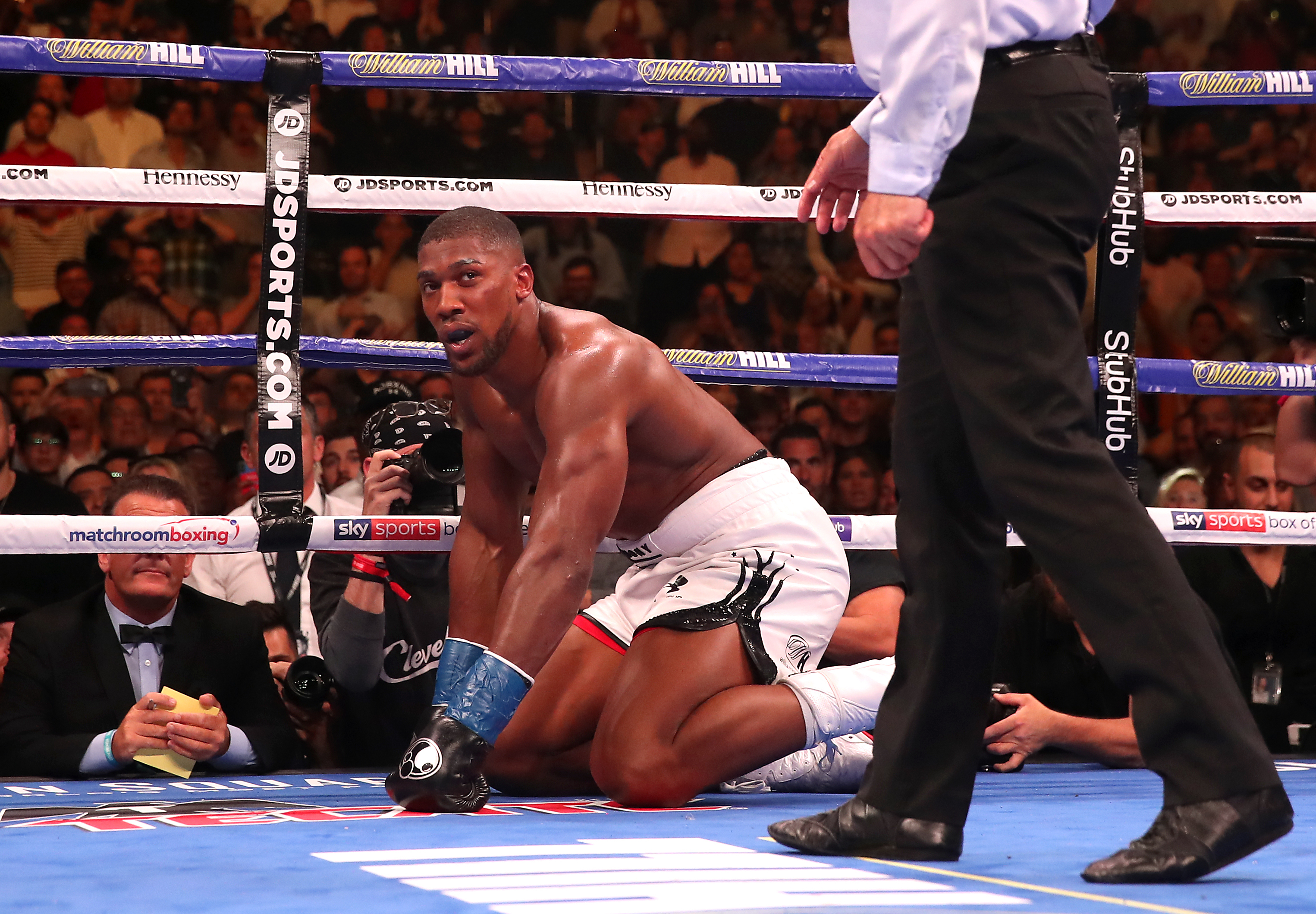 Joshua being counted down during the bout by referee Mike Griffin (Image Credit: PA)