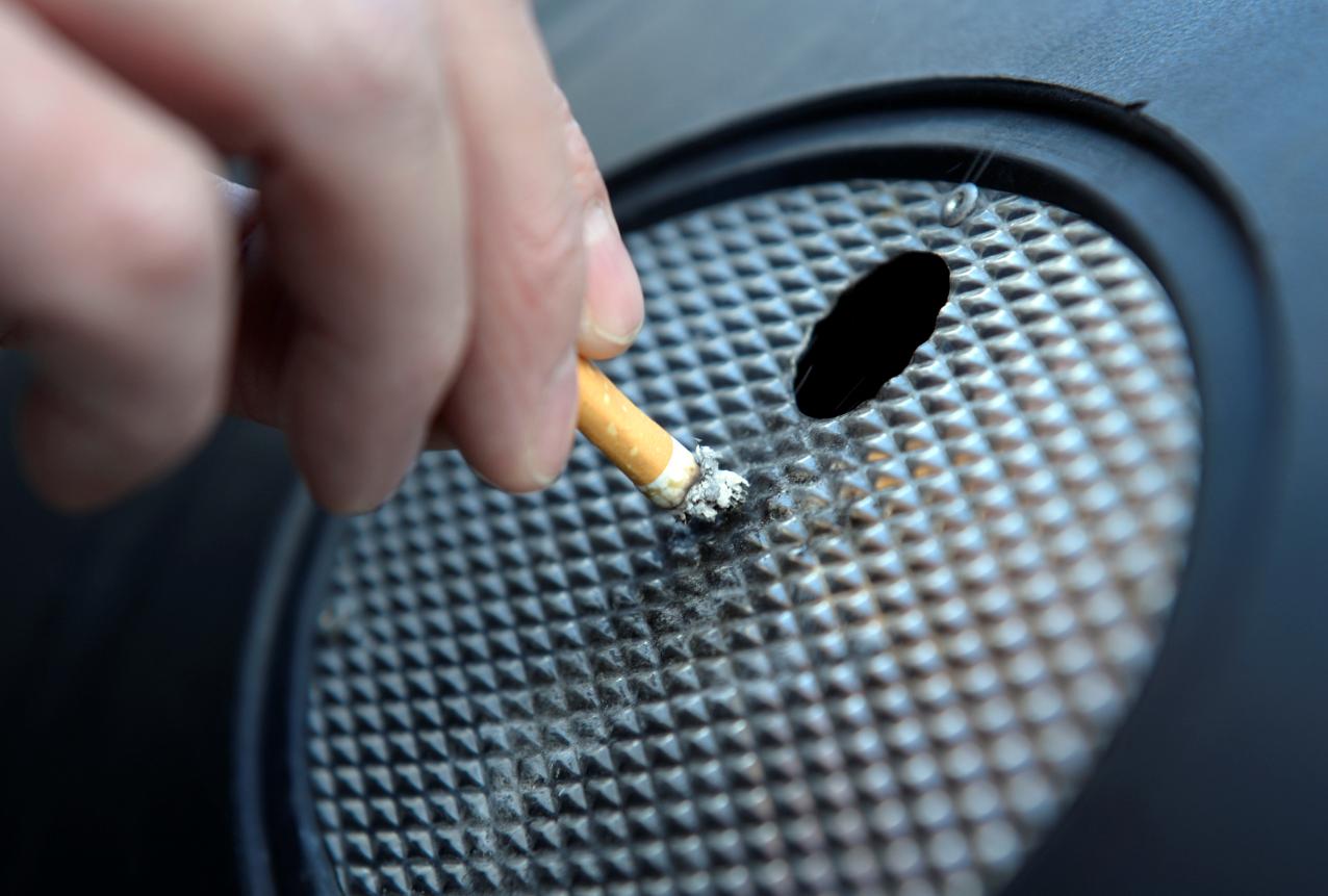 A person stubbing out a cigarette. Credit: PA