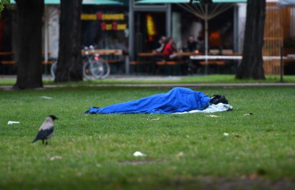 Sleeping homeless in a field