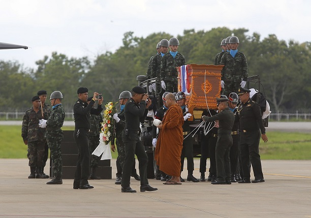 The body of Saman Gunan is carried during a repatriation and religious rites ceremony in Thailand. Credit: PA