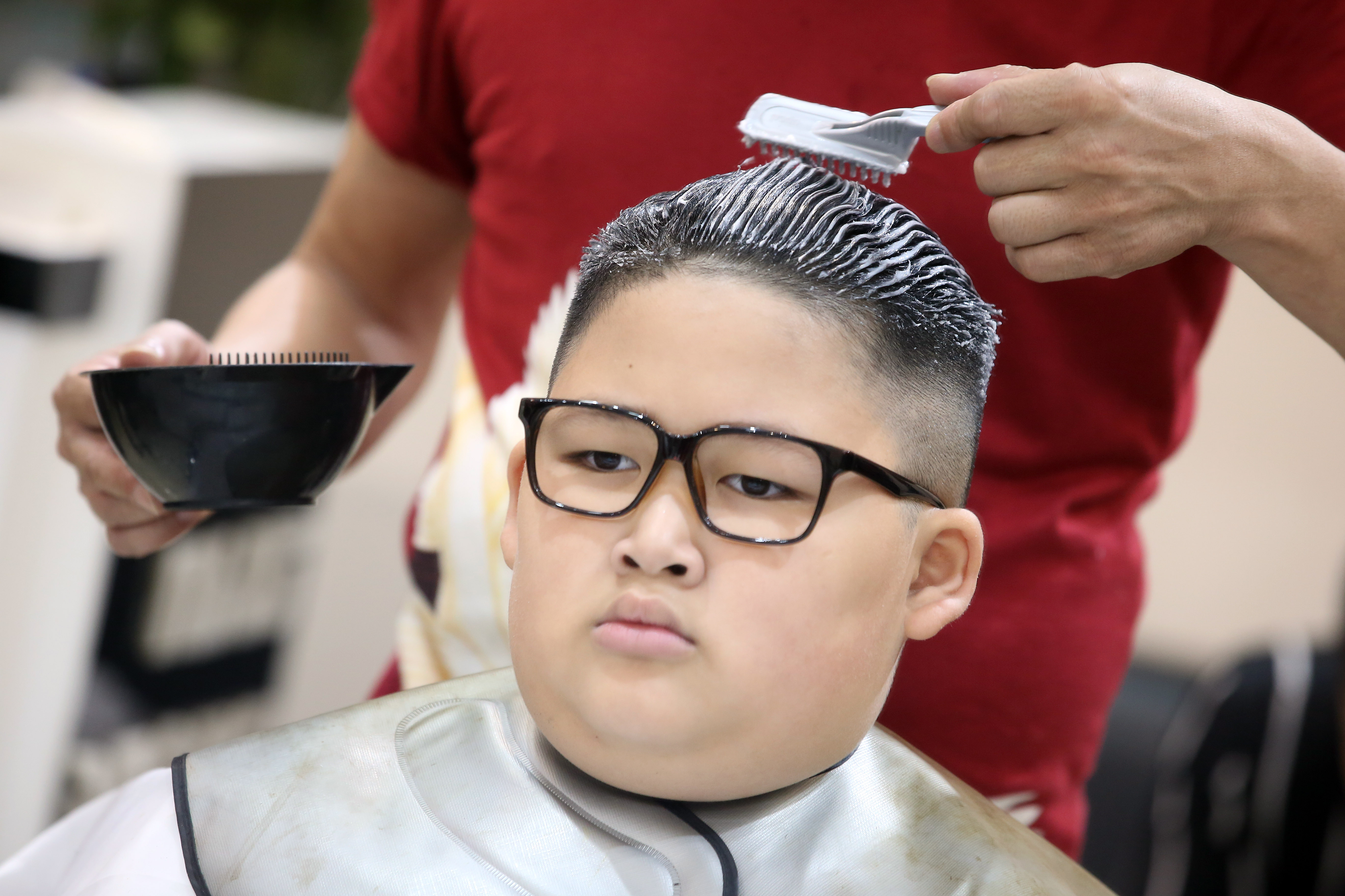 Back in my day nine-year-olds used to get the Nike swoosh shaved into the sides of their heads. Credit: Shutterstock