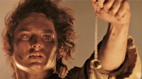 Frodo loves this ring a little too much. Credit: New Line Cinema
